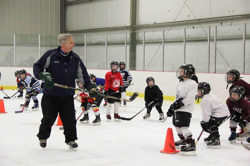 Children practicing hockey