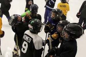 Young hockey players huddle together